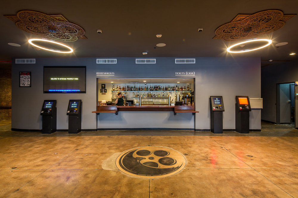 Concession stand and interior of the Nitehawk Cinema at 188 Prospect Park West in Brooklyn with MEP-FP engineering provided by 2LS.