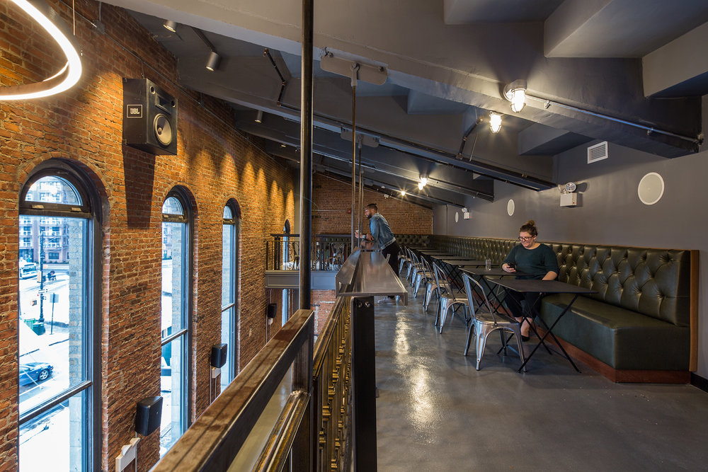 Upper level of the exposed brick interior of the Nitehawk Cinema at 188 Prospect Park West in Brooklyn, with MEP-FP engineering services provided by 2LS.