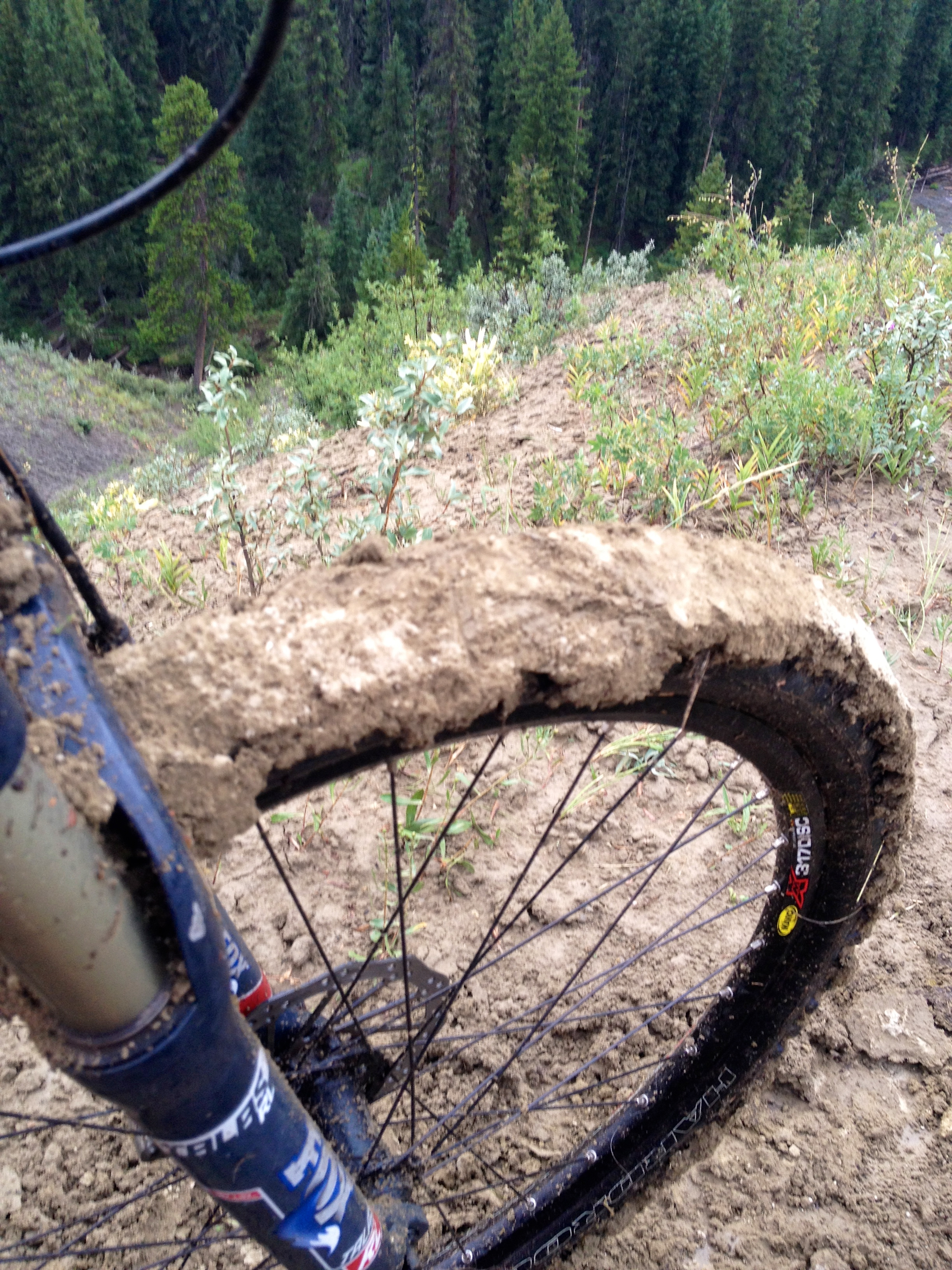Muck adds a challenge (notice the steep drop off next to the trail).