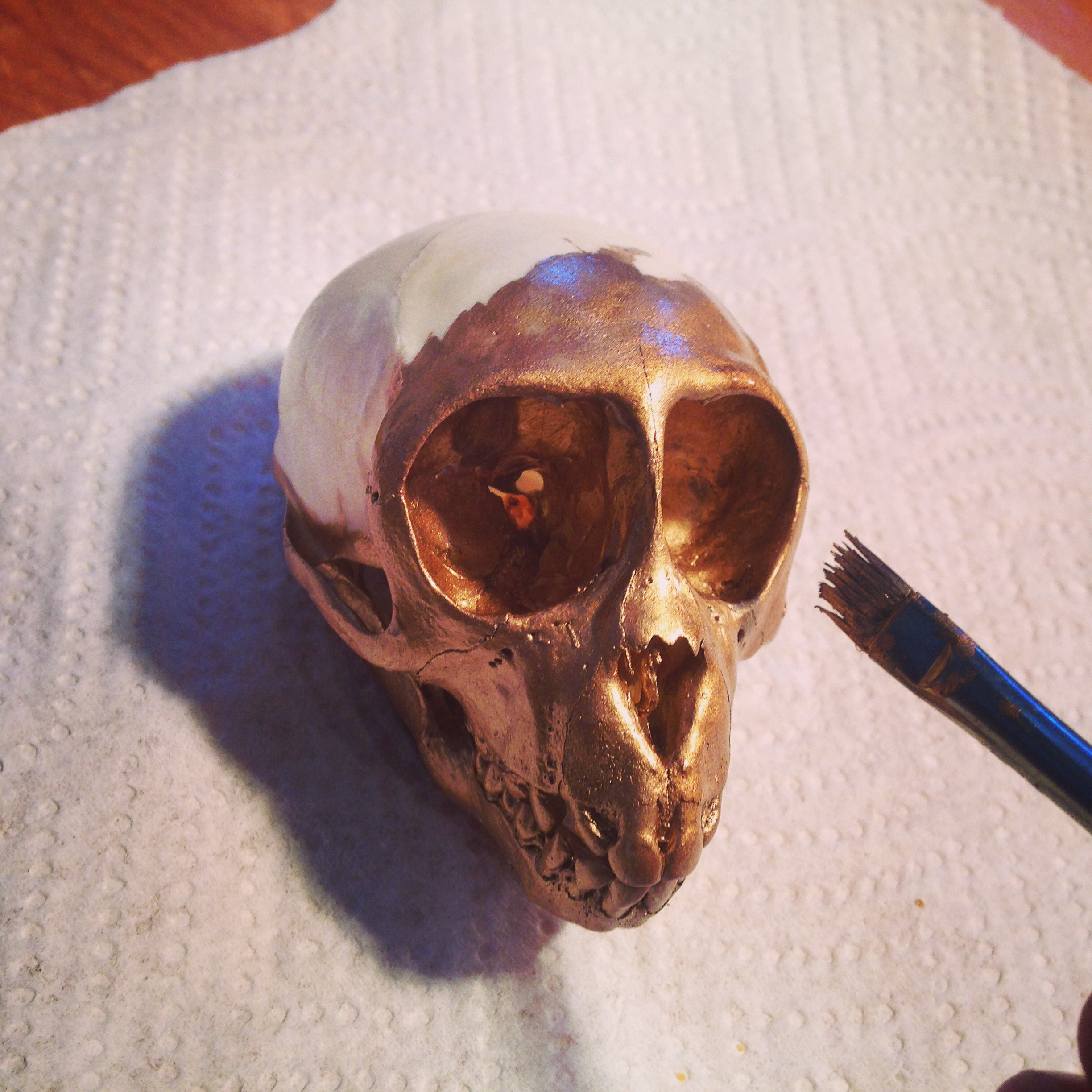 My collector requested the little skull in gold.  I thought myself pretty attached to the beauty of a bone-white skull but...