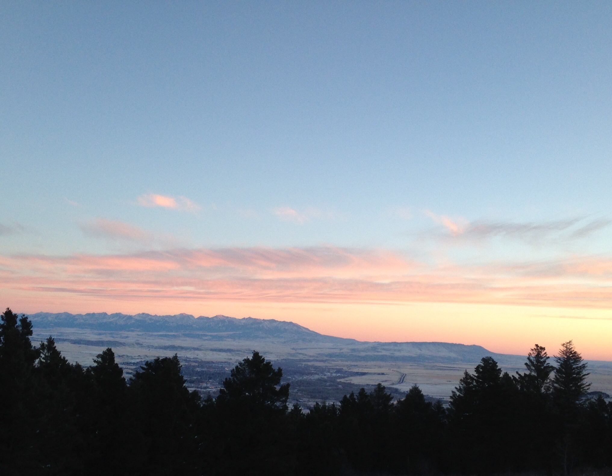 Sheep Mountain wakes up with a sigh beneath the soft winter flannel sky