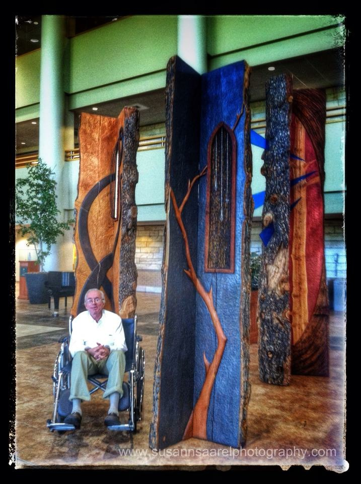Susan's photo of her husband Doug among the sculpture installation at Billings Clinic last year