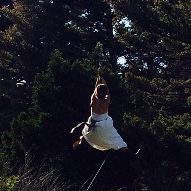 Merry on my hipline, her new husband in the tree to catch her as we celebrated her marriage at my studio two weeks after the attack.  What a blessing!