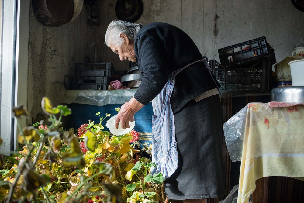 Grandma Chrisoula, watering her plants.