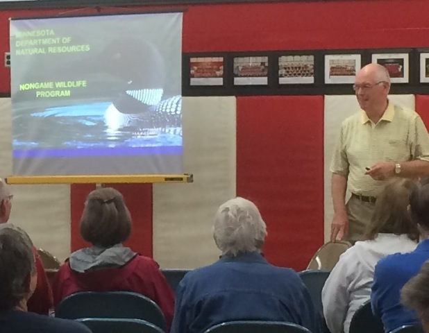 With over 35 years as a non-game wildlife champion, Carrol Henderson, Minnesota DNR, talked about loon migration patterns at the Aitkin Rivers and Lakes Fair, June 20.