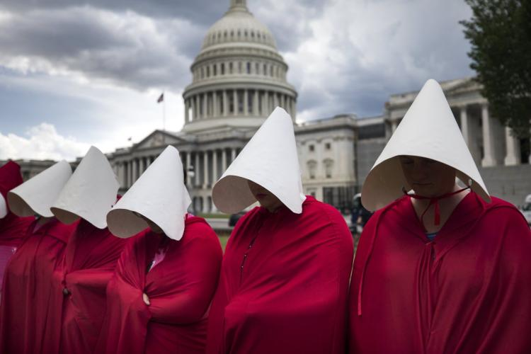 Image:   Women gather outside the capitol building in Washington D.C. to protest the confirmation of SCOTUS nominee Brett Kavanaugh.