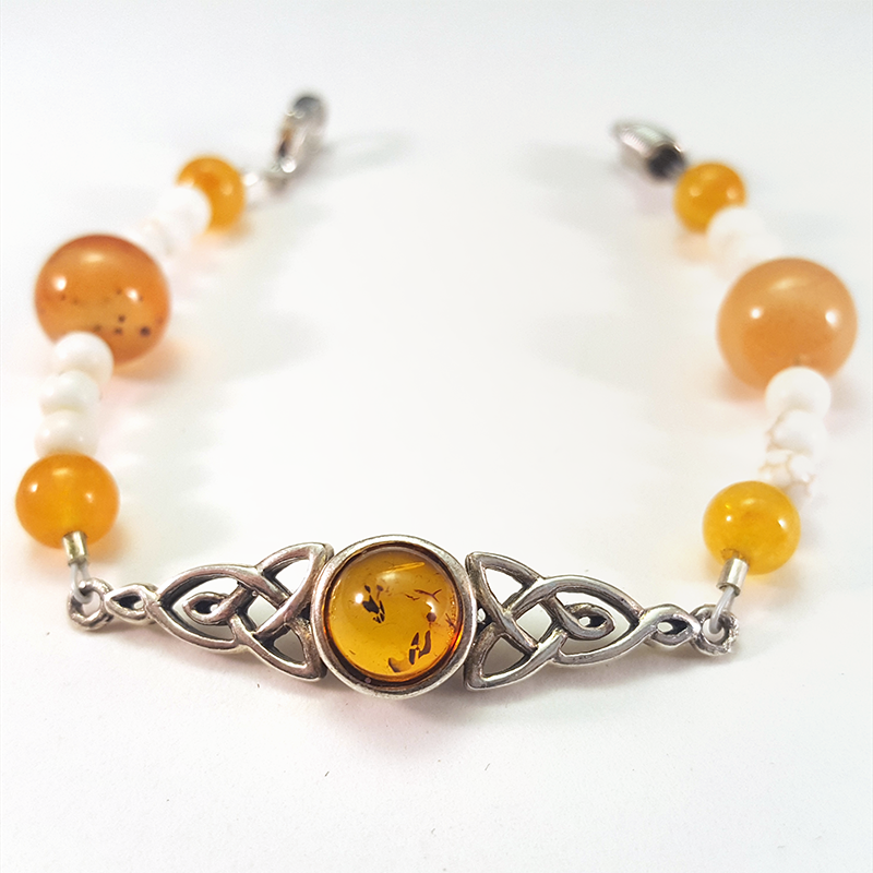 Amaterasu   Channel the power of the sun with this amber bracelet!  *Inner pendant purchased from 3rd party artist.