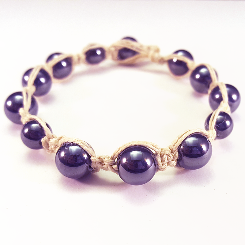 Zen   Attain inner piece with this soothing bracelet made with white hemp and hematite.