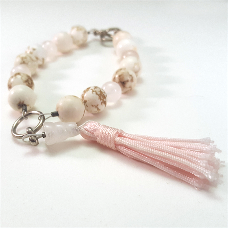 Pink Mala Bracelet   This bracelet is inspired the design of a Buddhist mala, and was created for protection and peaceful dreams.