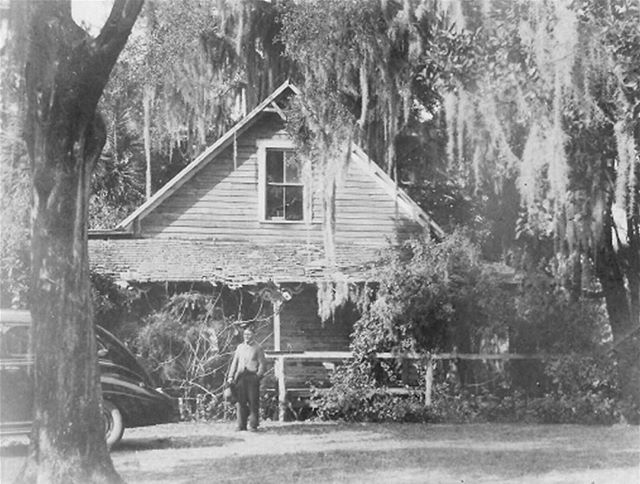 The original homestead of Lake Mary co-founder, Dr. William Harrison Evans, built in the 1880's. A good depiction of Florida pioneer/vernacular architecture. This photo was taken in 1940 (with Dr. Evan's son standing in front) just before it was torn down.