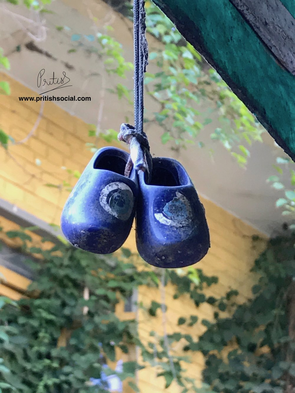 Cute little shoes hung outside the kitchen