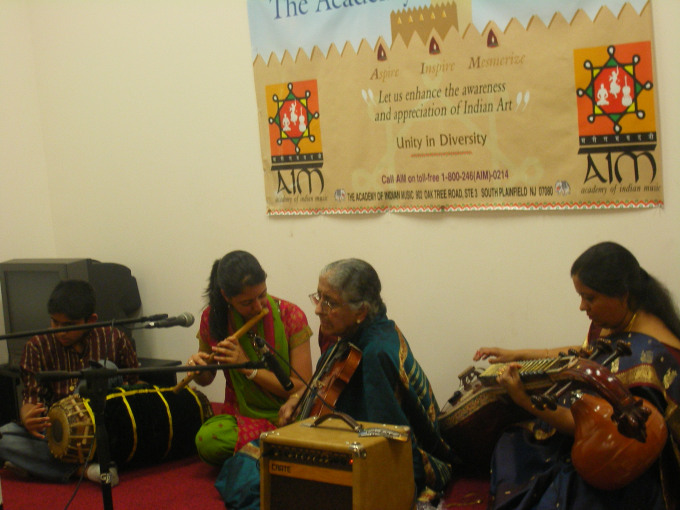 Rasika Shekar (flute), her brother (Mridangam), her grandmother (Violin), and her mother (Veena) performing live