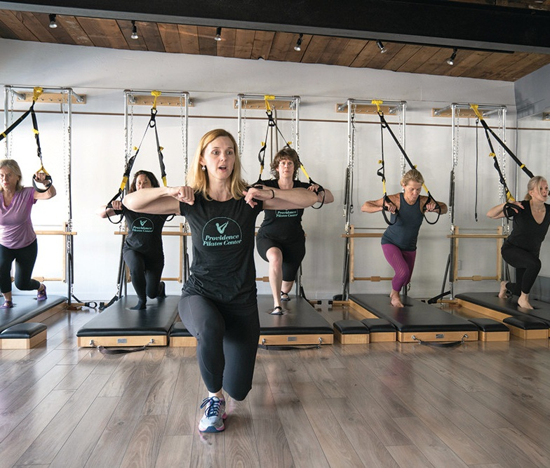 Above: Cheryl Turnquist leads a group class. Photo credit; Providence Monthly