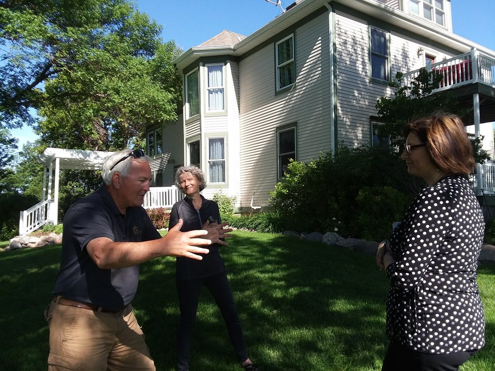 Dave Larson tells the story of Rustic Oaks to Sheri Holm of West Central Initiative while Anne Larson looks on.