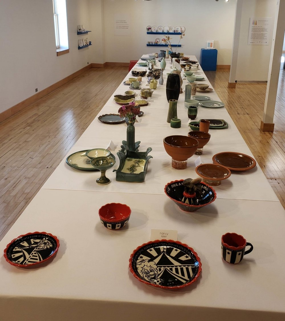 This ceramic pottery display featuring table place settings can be viewed through January, 2019.
