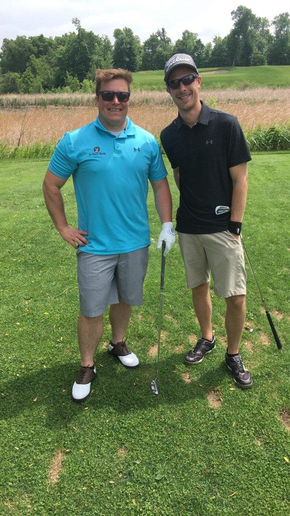 Grant Haugen (right) and a golfing buddy.