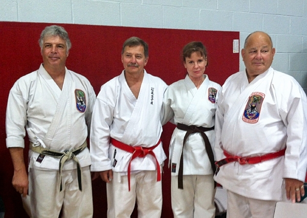 Leslie with her Isshinryu Karate teachers at the annual tournament, 2015. From left: Sensei Don Gyr (her primary instructor), Shihan Mitch Kobylanski, Leslie, and Shihan Lewis Lizotte.