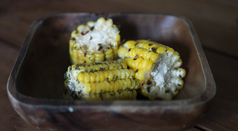 A welcome snack of roasted corn served within wooden bowls that I resisted the urge to steal