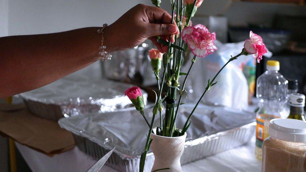 Rachel putting the floral arrangements together...