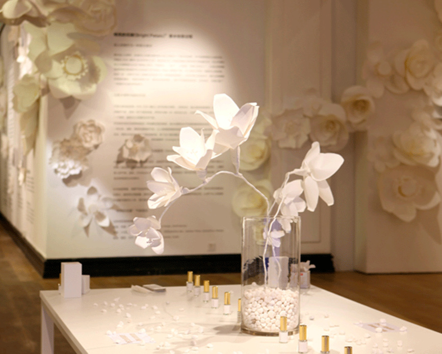 Large paper flower design as a perfume tester
