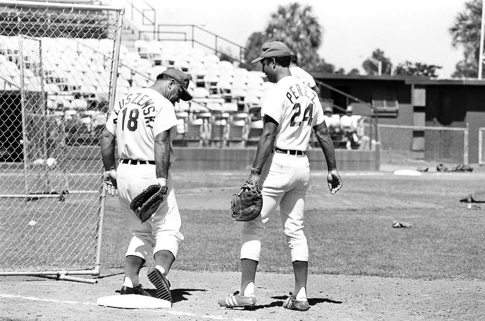 "Tony receives fielding advice from another beloved Reds first baseman, Ted Kluszewski in spring training, 1972. ""Big Klu,"" a fellow slugger from two baseball generations earlier, was the team's hitting instructor."
