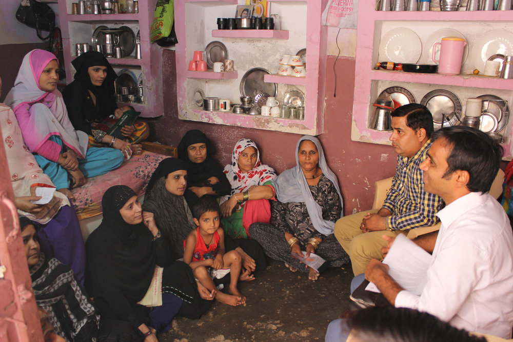 Ujjivan Customers gathered in a house