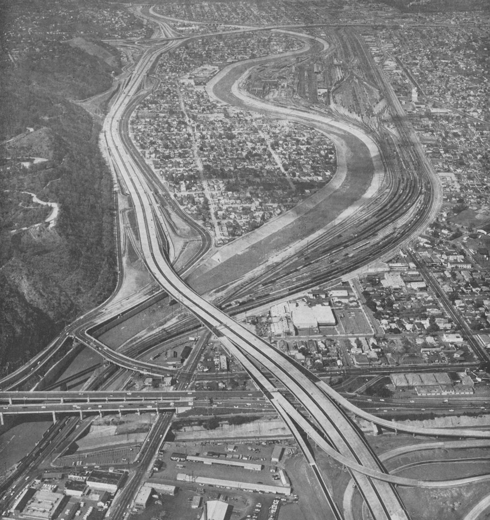 12. Aerial view looking up river just after Interstate 5 construction, 1962
