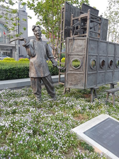 During our search or food, we passed an arts complex that included several statues of famous cultural figures from China's past. This one may have been a comedian.