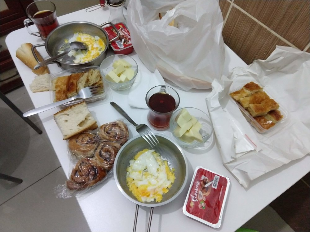 Aside from the sweet rolls that I brought, my host provided everything in this feast: cheese, eggs, tea and two kinds of bread.