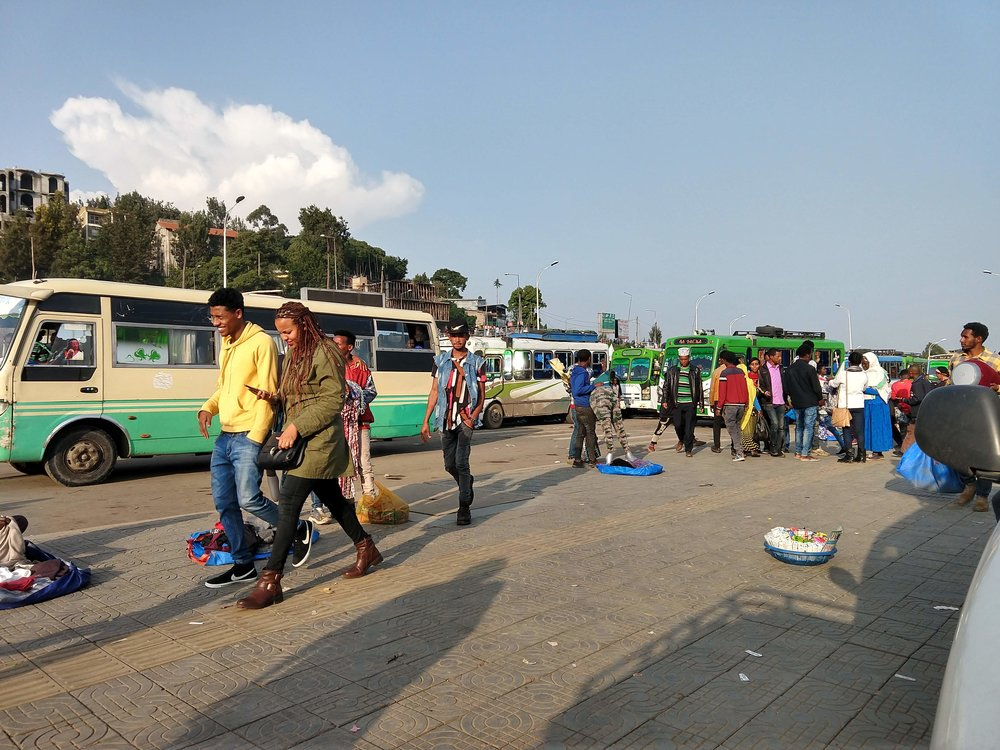 Part of the market where I caught my first mutatu (the brown-and-green bus in the background).