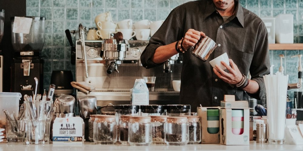coffee cart - Open at 7 am, the coffee cart brews locally roasted Flag & Wire beans and offers small breakfast and seasonal items. Wired with excellent wifi and furnished with multiple seating areas, Mac Market is a great place to stay and work.