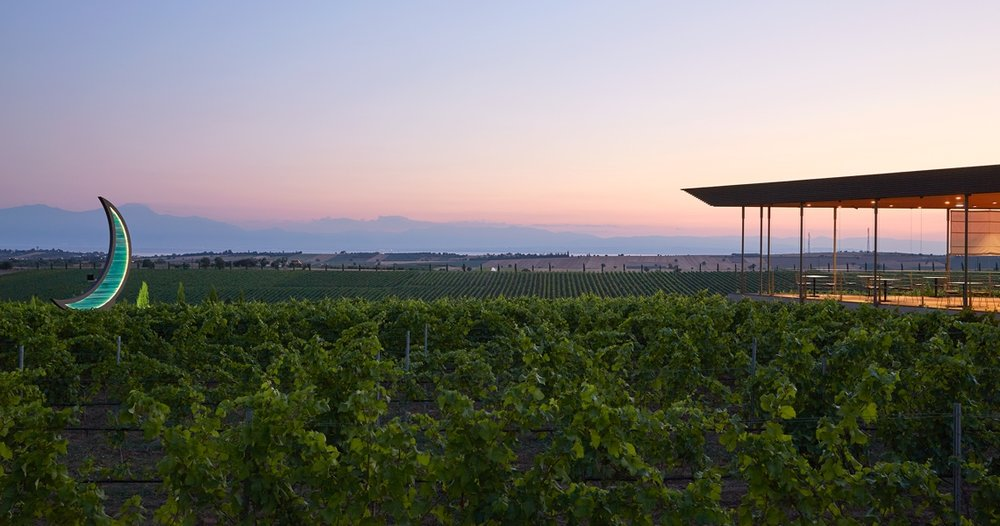 The patio at the winetasting room, Ktima Gerovassiliou. In the background is the bay of Thessaloniki and mountain ranges near Mount Olympus.