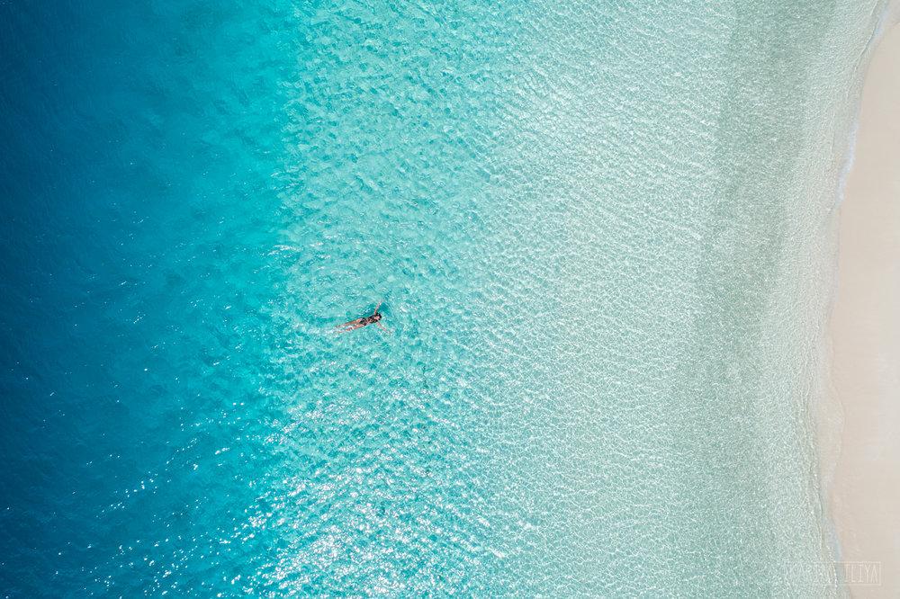 drone-island-tonga-clear-water.jpg