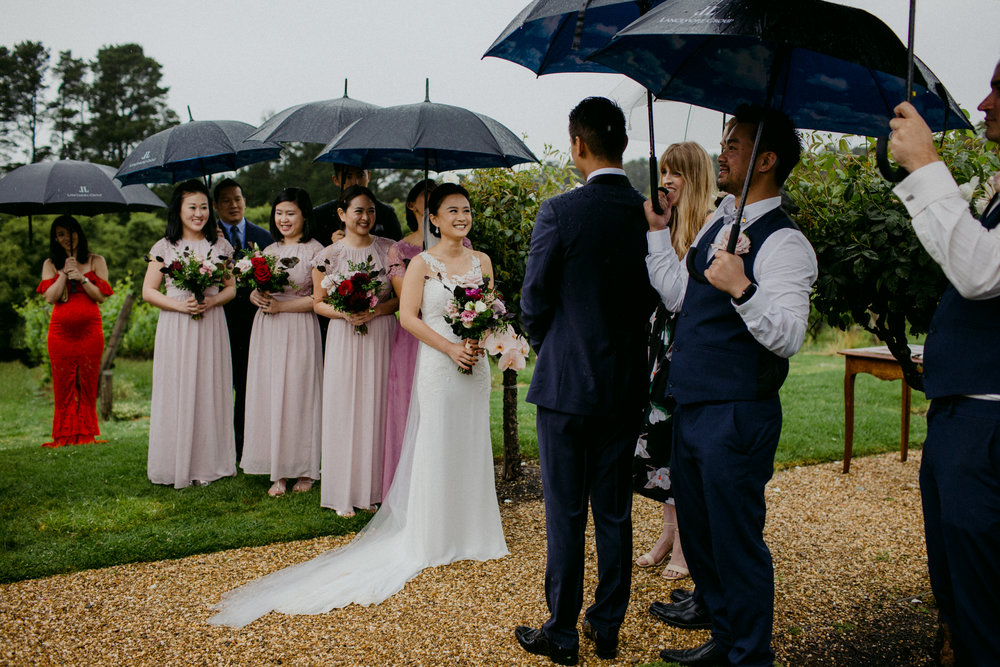 Melbourne celebrant Weddings by Jess is the celebrant who will create your perfect ceremony, rain hail or shine! Smiling and gorgeous bride and groom Matt and Mel getting #marriedbyJess on their wedding day at Lindenderry Red Hill in the Mornington Peninsula