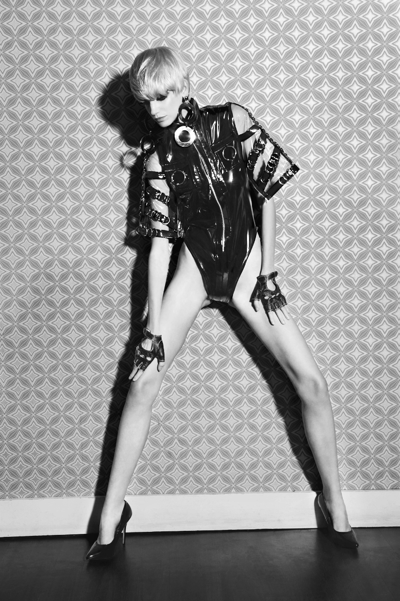 Patent leather bodysuit  Alon Livne, EARRINGS LARUICCI,  Heels  Christian Louboutin,  Fingerless leather gloves  stylists own