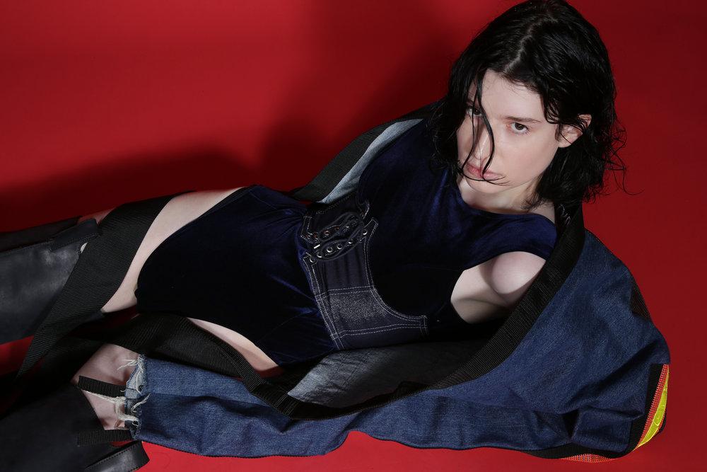 Denim jacket by  dope tavio at patricia field,  Velvet bodysuit, denim corset belt and leather boots by  Hardeman