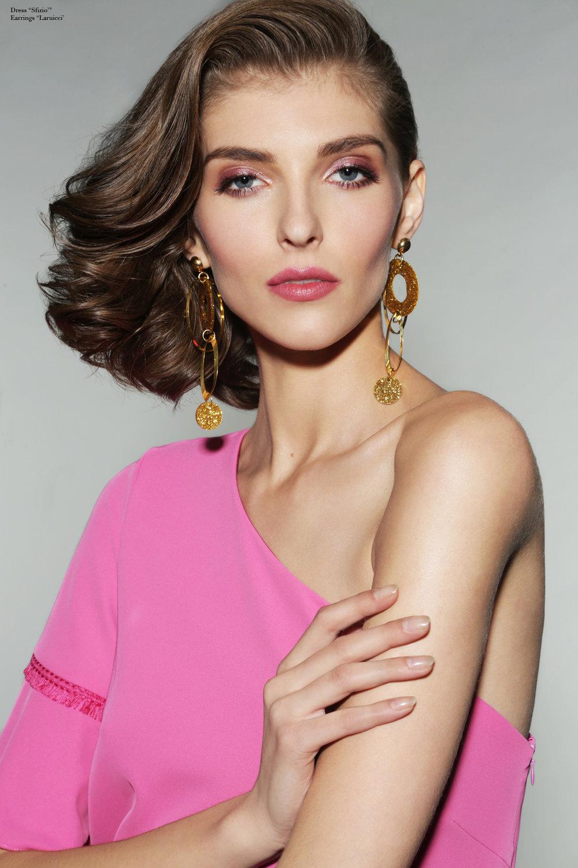 Dress by  Sfizio,  Earrings by  Laruicci