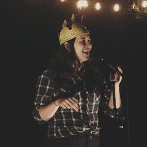 Katie Elkins, Founder - Katie Elkins is one of the founders of FarmPROV. She is passionate about bringing the joys of live comedy to an unconventional audience by moving the art outside of the traditional theater space.