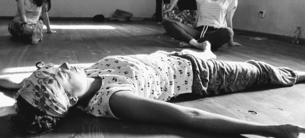 Relaxing into the floor.jpg