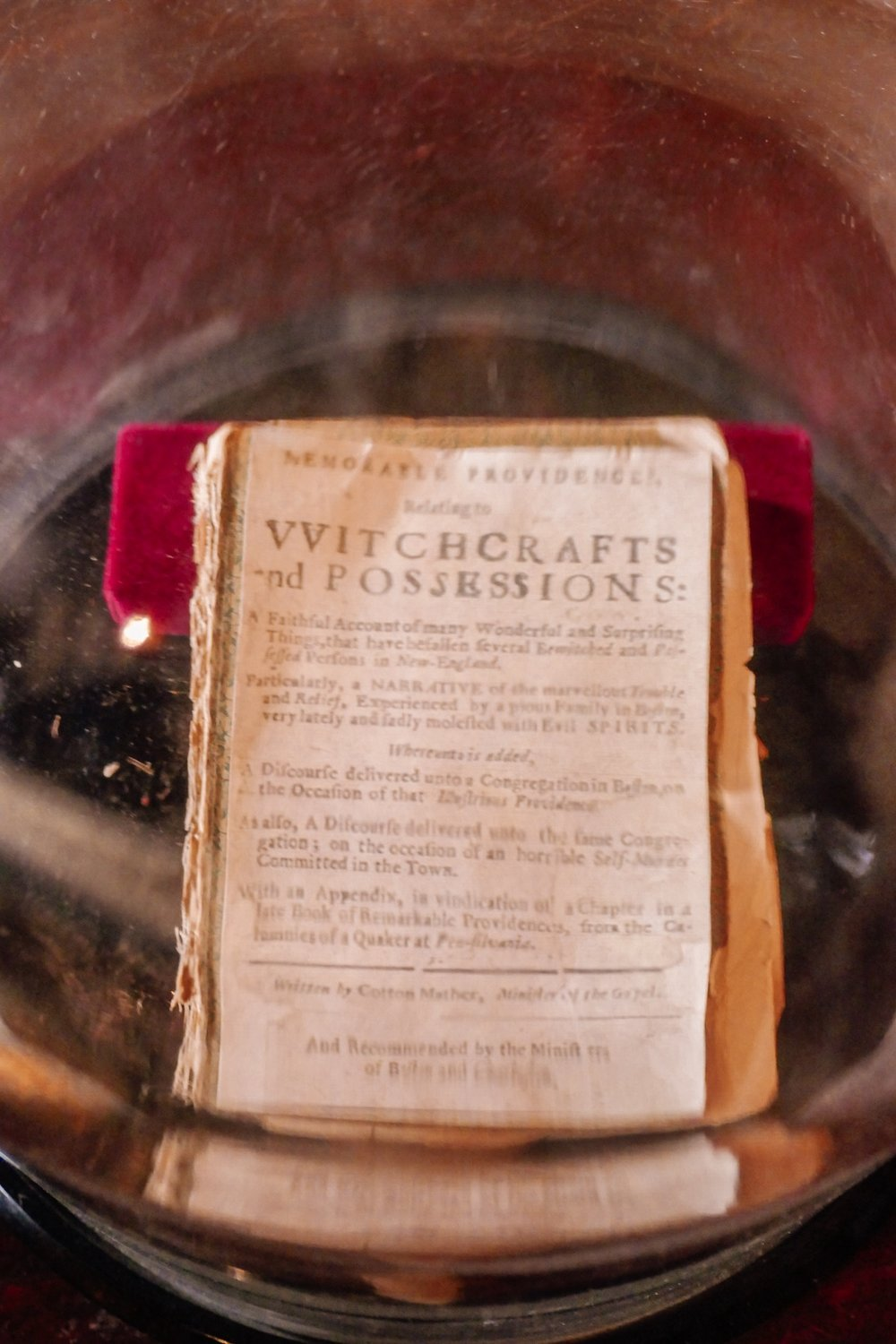 Book dating back to the Salem Witch Trials Inside Glass Case