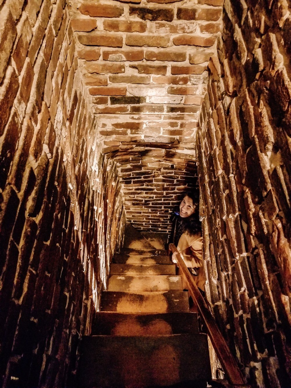 Climbing up the secret staircase in the Hosue of the Seven Gables