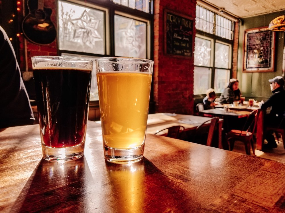 Beers on a table at Mercy's Tavern in Salem Massachusetts