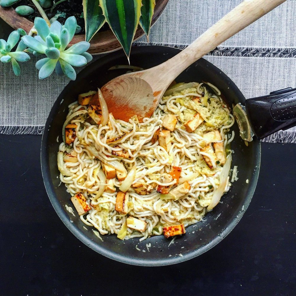 Protein train - This dish is something that was born out desire of texture and guilt from eating kinda really bad on weekend :DYou can basically alter this dish in a slice of baked tofu having pesto as a spread on top. Despite being all tofu, noodles and smoked bits have different firmness and smoothness to it, which provides texture variety that i so need on diet. On it's own cooked tofu may feel like it's missing some fatness or softer body (especially if you're not used to it). It can usually be counteracted by oils from the dish (if, let;s say, it's stir fry of some sort), but i'm trying to lose weight, so I got creaminess by adding softened onions that also add a bit of sweetness to smoked tofu. And we need some acidity to break all those rich flavors, so instead of sweeter green pesto i chose artichoke and lemon mixture with reduced oil, just a tablespoon for a whole cup of pesto. A bit of oil is good, it's about as much you'd have on your salad ;) just need to make sure i won't be having any today ... Almost 30 g of protein on one plate!