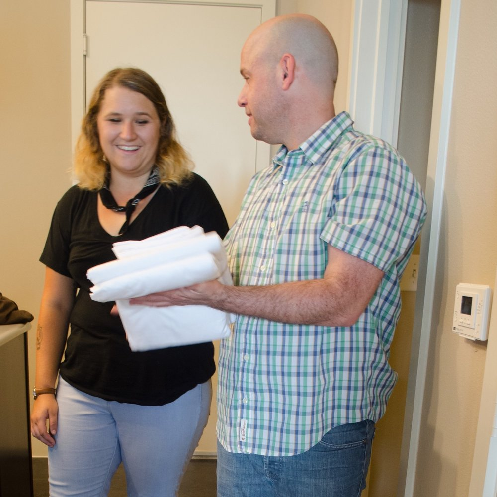 Ashley, a case manager at AIDS Services of Austin, opens a COCObundle with our first beneficiary, Michael.