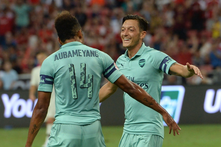 Mesut Özil (pictured right) captained the Gunners to a 5-1 victory against PSG 2 weeks ago.