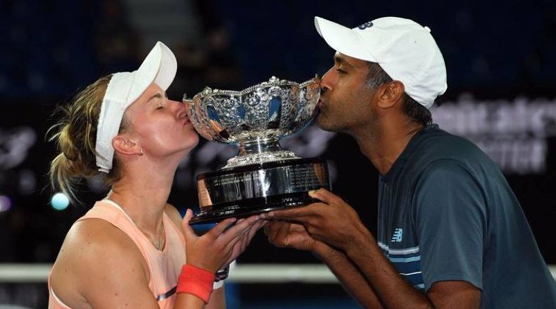 Rajeev Ram and Barbora Krejcikova lifting the Australian Open Mixed Doubles 2019 Trophy. Source: Twitter/@ausopen