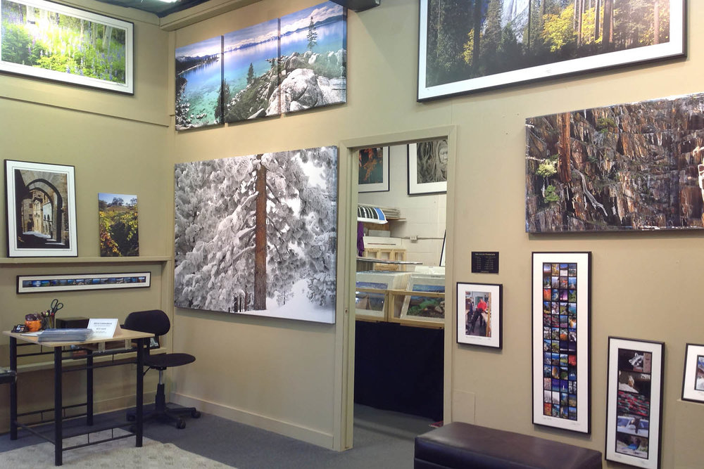 Dirk Yuricich Photography Studio-Gallery showing large photographs on canvas and photographic paper as well as small pieces.