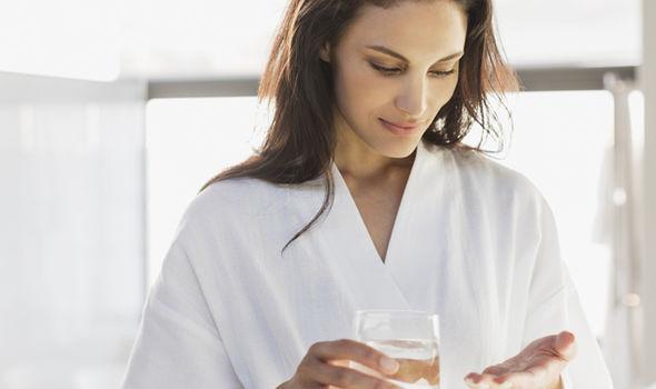 Woman-taking-pill-689735.jpg