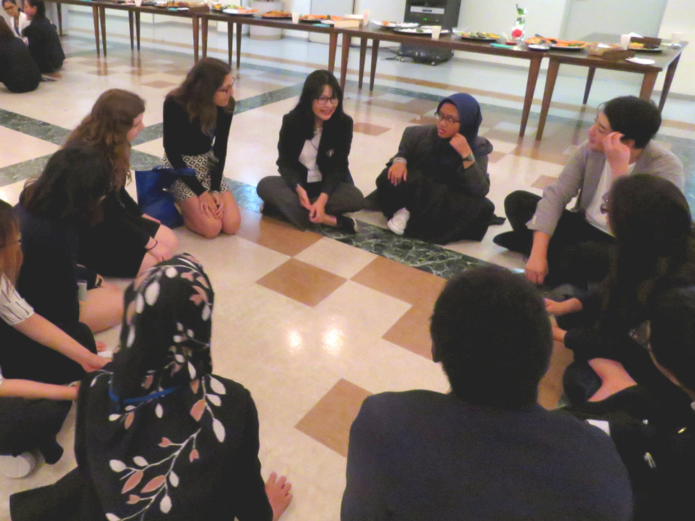 Delegates enjoy ice-breaking games during Day 1's social event.