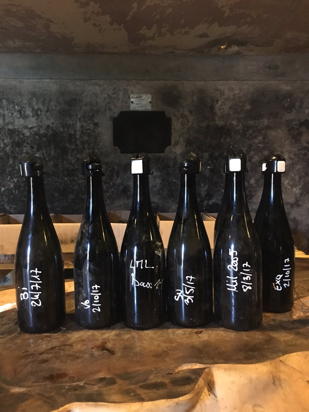 a lineup of Selosse wines (unlabeled)